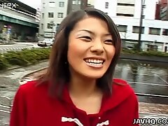 Brunette slut Reika Fujii walks in the public place and flashes her tits