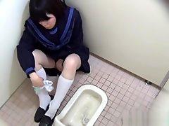 Asian Teen Rubs Her Vag