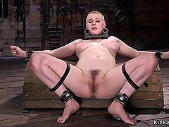 Busty hairy slave in metal device bondage