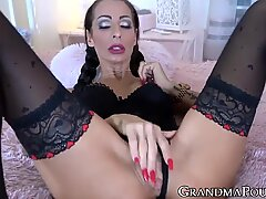 Mature lady in stockings uses dildo and vibrator on wet puss